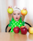 Happy Kid with apples. Royalty Free Stock Photos