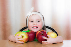 Happy Kid with apples. Royalty Free Stock Images