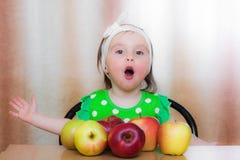 Happy Kid with apples. Stock Image