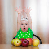Happy Kid with apples. Royalty Free Stock Photo