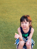 Happy kid, asian baby child eating a  cookie Royalty Free Stock Photos