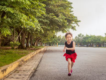 Happy kid, asian baby child running Royalty Free Stock Image