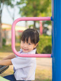 Happy kid, asian baby child in school uniform playing Stock Photo