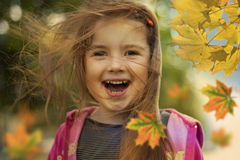 Happy kid and autumn leaves royalty free stock photos