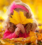 Happy kid in autumn park Royalty Free Stock Photos