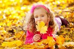 Happy kid in autumn park Royalty Free Stock Photos