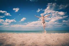 Happy kid on a baech. Instagram stylisation. Little happy boy jumping on Black sea sandy beach. Instagram stylisation stock photos