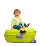 Happy kid with baggage Stock Photo
