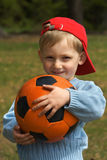 Happy kid with a ball Royalty Free Stock Images