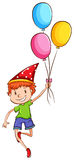 A happy kid with balloons Stock Photography