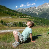 A happy kid is basking in sunlights royalty free stock photography