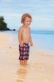 Happy kid on the beach Stock Photo