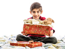 Happy kid in bed with opened gift box Stock Photography