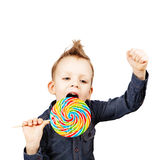 Happy kid with a big candy Stock Photos