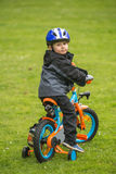 Happy kid with bike in park Royalty Free Stock Images