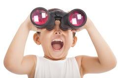 Happy kid with binoculars. Isolated on white Stock Photo
