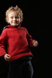 Happy kid on black background Stock Photos