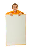 Happy kid with blank placard Royalty Free Stock Photos