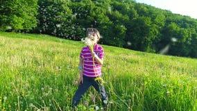 Happy Kid Blowing Dandelion Flower. Slow motion stock video
