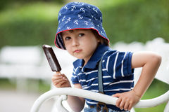 Happy kid boy eating ice cream Royalty Free Stock Photography