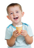 Happy kid boy eating ice cream in studio isolated Royalty Free Stock Photo