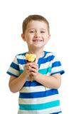 Happy kid boy eating ice cream in studio isolated Stock Image