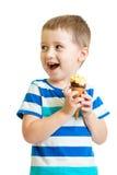 Happy kid boy eating ice-cream in studio isolated royalty free stock photography
