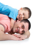 Happy kid boy and his dad lying on the floor Stock Photos