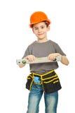 Happy kid boy holding bubble level Royalty Free Stock Photo