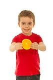 Happy kid boy holding orange Royalty Free Stock Photos