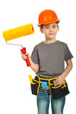 Happy kid boy holding paint roller Royalty Free Stock Images