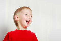 Happy kid boy making funny silly faces Royalty Free Stock Photo