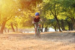 Free Happy Kid Boy Of 7 Years Having Fun In Autumn Park With A Bicycle On Beautiful Fall Day. Active Child Wearing Bike Helmet Stock Photos - 159834813