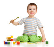 Happy kid boy with paints Royalty Free Stock Photos