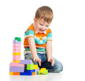 Happy kid boy plays over white Royalty Free Stock Images