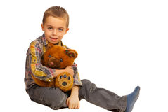 Happy kid boy with plush bear Stock Image