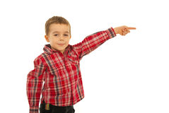 Happy kid boy pointing away Stock Photos