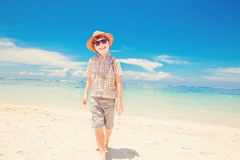 Happy kid boy in summer hat and hipster sunglasses Stock Photos