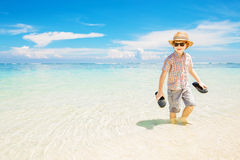 Happy kid boy wearing summer hat and hipster Stock Image