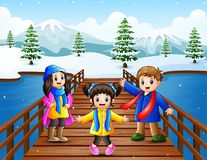 Happy kid on the bridge in the snowing hill. Illustration of Happy kid on the bridge in the snowing hill Royalty Free Stock Photography