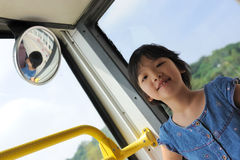 Happy kid in bus Royalty Free Stock Photo