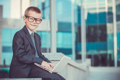 Happy kid businessman with laptop Royalty Free Stock Photo