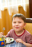 Happy kid with a cake Royalty Free Stock Photo