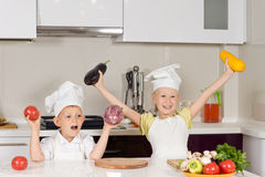Happy Kid Chefs Holding Fresh Vegetables Royalty Free Stock Image
