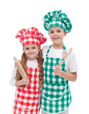 Happy kid chefs with wooden cooking utensils Stock Photos