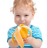 Happy kid or child eating banana Royalty Free Stock Photo