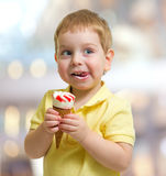 Happy kid or child eating icecream stock photography