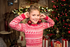 Happy kid with Christmas baubles Stock Photography