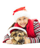 Happy kid in Christmas hat. And puppy on a white background isolated Stock Image