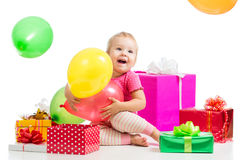 Happy kid with colorful balloons and gifts Stock Images